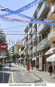 CALELLA, SPAIN - JULY 19, 2013: Streets of Calella on July 19, 2013. City on the Costa Brava - a popular holiday destination of tourists from all European countries