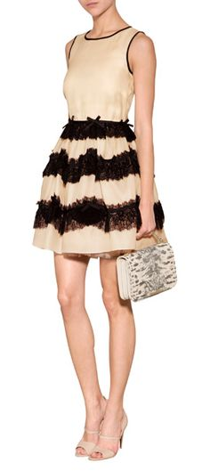 A pretty choice for dress-up, RED Valentino's lace-laden dress features a vintage nude-black color mix and delicate bow embroidery #Stylebop