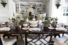 Black lacquered Chinese Chippendale chairs with white seats (and black shiny table)