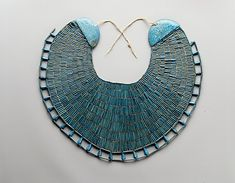 Funerary Broad-Collar of Wah    Period:      Middle Kingdom  Dynasty:      Dynasty 12  Reign:      reign of Amenemhat I, early  Date:      ca. 1981–1975 B.C.  Geography:      Egypt, Upper Egypt; Thebes, Southern Asasif, Tomb of Wah (MMA 1107), Mummy, in wrappings on chest, MMA 1920  Medium:      Faience, linen thread