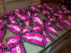 How To Make a Big Cheer Bow yourself. Follow these step-by-step instructions to make your own cheer bow. It's easy and doesn't take a lot of tim
