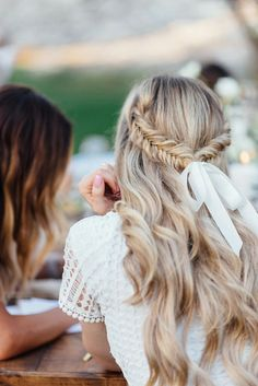 Beautiful fishtail side braids with loose curls