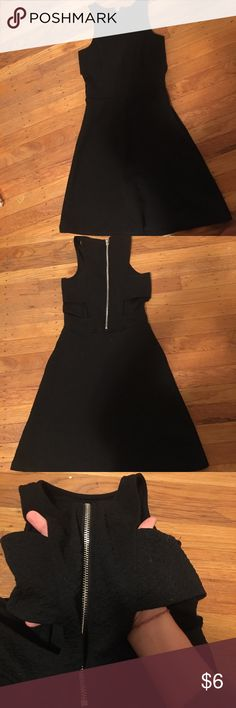 Black skater dress, tight fitting cool cut out Black H&M dress, tight fitting flowy at bottom COOl cut out in back. Stretchy material H&M Dresses