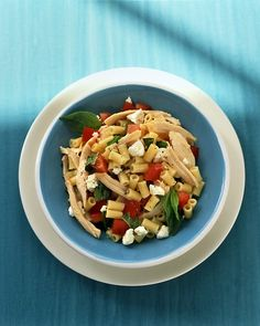 Pasta with Chicken, Tomato, and Feta-        In a large pot of boiling salted water, cook pasta until al dente, according to package directions. Drain; rinse well under cold water.        Transfer to a large bowl; toss with oil, lemon juice, feta, tomatoes, chicken, and basil; season generously with salt and pepper. Serve at room temperature or chilled.