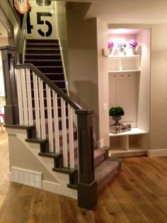 Gray and white stair rail and entry nook: Copper Woods Homes and Osmond Design, 2014 Utah Valley Parade of Homes.