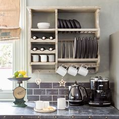 The owner put together flea-market finds and vintage and upcycled furniture to create a one-of-a-kind kitchen diner that's cosy and bright
