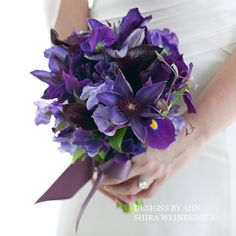 Like the Iris. Could change the colour to this purple?? would look fine with the blue
