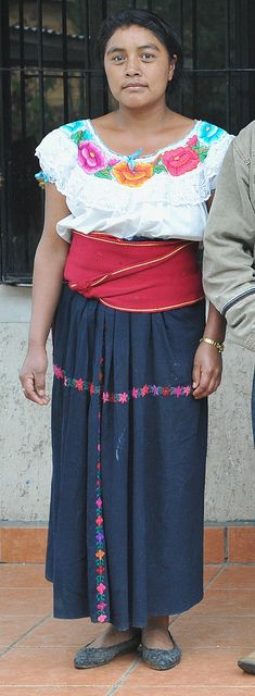 Huixtan Woman Mexico    This woman lives in Huixtan, a Tzotzil Maya town in the highlands of Chiapas, Mexico. A friend asked to see a photo of a woman wearing the pretty embroidered blouse of the community. The blouses are worn with wide red belts and indigo dyed wrap skirts.