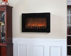 Black Wall Mounted Electric Fireplace. View more electric fireplace inserts online at http://www.shopchimney.com.