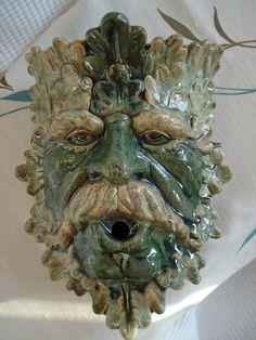 Ceramic Green Man wall sconce Moss Green. $36.00, via Etsy.