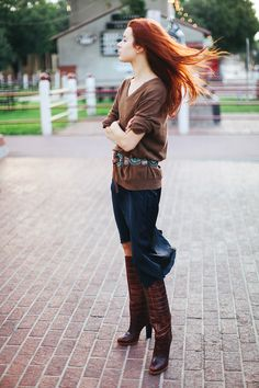Black slip dress with J. Crew sweater, vintage concho belt and Lucchese Mila boots. (via Sea of Shoes)