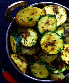 This simple dish of Indian-spiced potatoes and zucchini is a total flavour bomb! Two main ingredients and a handful of spices make up this tasty vegan or vegetarian dish. Can be served as a side or main along with rice and naan or chapati.