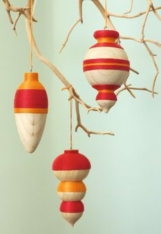 """Thread & Wood Christmas Ornament DIY tutorial, by """"Urban Comfort"""". These ornaments arereally easy to make and you can swap out the color palette for one that suits your personal decor."""