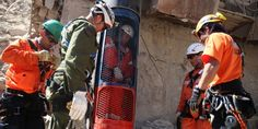 Rescue workers practice a dry run with one of the capsules that would be used to liberate the trapped miners at the San Jose mine near Copiapo, Chile on October 11, 2010.