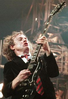 50. Angus Young of AC/DC - There are few more exhilarating sights in music than Angus Young tearing across the stage with a manic glint in his eye and a guitar in his hands. The Australian is famed for his ridiculous school uniform stage clothes, pretending to have fits while playing and general madcap behaviour. But his antics and simplistic style mask a more than competent musician. (wenn)