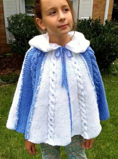 Free Knitting Pattern for Nadia Poncho with Hood - Knitted in seed stitch with a single cable running through the middle of each panel and topped with a hood. Worsted weight. Size child 10-12. Designed by Maria Keffler