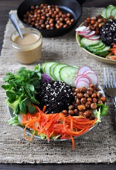Buddha Bowl.   A nourishing vegan bowl of black rice, pea shoots, pickled carrots & spiced chick peas. Food Well Said