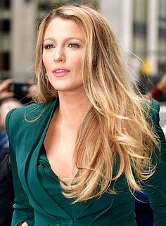 Simple makeup, pink lips, and volumized but straight hair, just curled on the ends and gently right up by the face. Blake Lively Just Gave Us A Major 'Wow' Moment
