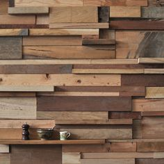 Slowpoke Cafe in Melbourne by French designer Sasufi features a wall covered in timber offcuts The 12 meter long wall was created from timber offcuts collected from a variety of local furniture makers who use recycled timber themselves. . http://www.dezeen.com/2011/06/14/slowpoke-cafe-by-sasufi/