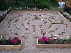 "A stone and sand labyrinth by Backyard Labyrinths. Very simple but the plain wood border gives this a real ""zen"" feeling dont you think?"