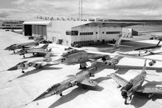 """U.S. Navy and U.S. Air Force aircraft at the General Electric flight test facilities at Edwards Air Force Base, California (USA). The following aircraft are visible (l-r): McDonnell F-101A Voodoo..."