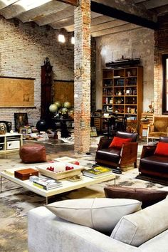 Contemporary Living Room with Greta coffee table, Exposed beam, Wall sconce, interior brick, Exposed brick, High ceiling