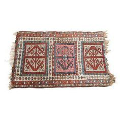 A sweet vintage rug from 1880-1915 with awesome colors and designs. This caucasian rug would make lovely little scatter carpet or conversation piece!