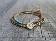 MATERIAL Om charm: Brass beads: SIZE One size. Triple Wrap, Brass Necklace, Yoga Jewelry, Adjustable Bracelet, Gifts For Husband, Hippie Boho, Delicate, Etsy Shop, Unique Jewelry