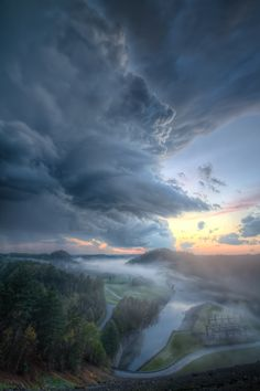 A monstrous thunderhead rolls over the river valley below South Holston Dam in Sullivan County, Tennessee