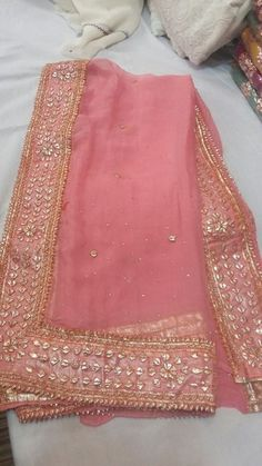 Designer Suit Hand Embroidered Gota-Patti Work Fabric: Chiffon Bottom: Silk Dupatta: Chiffon Whatsapp us at or CASH ON DELIVERY within days after order confirmation Made in Pakistan Pakistani Dress Design, Pakistani Outfits, Indian Outfits, Indian Beauty Saree, Indian Sarees, Bridal Dupatta, Silk Dupatta, Georgette Sarees, Embroidery Suits Punjabi