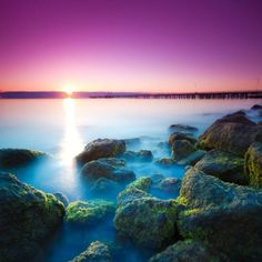 A very very magical sunrise in Shorncliffe Jetty, Redcliffe taken by Travis D who gets this on the reg! #sunrise #sea #rocks #mist #sand #sky #purplesky
