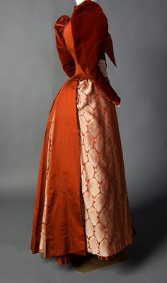 Rust-colored silk velvet, satin, faille, taffeta, and brocade day dress (back), by Mme. Lambele de St. Omer, American (New York), ca. 1891-92. Smith College Historic Clothing.