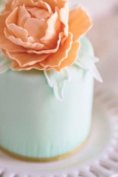 mint and peach wedding cake with beautiful rose