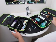 An organizer with built-in counter space. Customize the interior for your essentials, and slide the sides open to make a sink-covering surface.