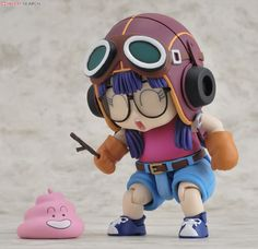 Arale playing with poop figurine