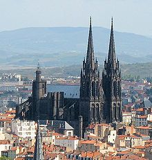 Clermont-Ferrand Cathedral is a Gothic cathedral, and French national monument, located in the town of Clermont-Ferrand in the Auvergne.  It is built entirely in black lava stone, which makes it highly distinctive, and visible from a great distance. Its twin spires are 96.2 metres tall, and tower above the town's rooftops.