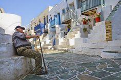 Old man sitting in the quarter of Kastro Greek Beauty, Man Sitting, Greek Islands, Santorini, Light In The Dark, Greece, Europe, Memories, Stone