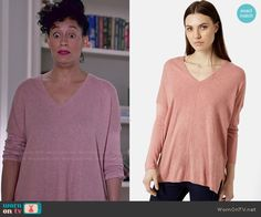 Rainbow's pink v-neck sweater on Black-ish.  Outfit Details: http://wornontv.net/49014/ #Blackish