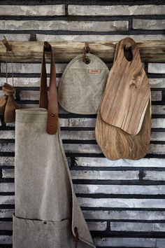 Let a beautiful canvas apron, tea cosy and teak cutting boards adorn in your kitchen. Hang the kitchen essentials on a teak rack to add warmth to the room. Leather Apron, Hanging Racks, Cabinet Making, Natural Shapes, Wooden Shelves, Wood Colors, Dark Wood, Leather Cord, Types Of Wood