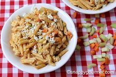 Buffalo Chicken Pasta Salad - This looks similar to the one I buy at the supper market, except the veg's are shredded not diced, and they use rotini pasta.