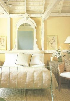 Beautiful yellow bedroom. Hate those dust collecting fake flowers ...