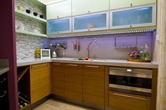 www.FaceYourKitchen.com Cabinet refacing with lots of original thinking turned this small northern European kitchen into a bright, efficient work space. Here are some features that you can consider adapting to your own small kitchen.