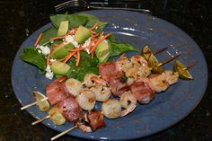 SCALLOP-SHRIMP-BACON KABOBS ~ Summer is coming, and that means the outdoor grill is coming into its own again. And since I prefer working the grill when it isn't blazingly hot outside…kabobs for dinner! What makes them so tasty is the bacon, though I did use it sparingly so it wouldn't overpower the seafood. A winner!