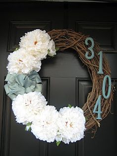 All I did to make these wreaths was wire the flowers through the vines and then hot glue the painted letters directly on the wreath.