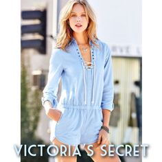 Victoria's Secret Romper Swimsuit Cover Up Gorgeous daydreamy blue romper with a rope lace up collar gives a glowing nautical vibe. Pockets on the shorts, cute buttons at the sleeves. Waistband is elastic but fabric is not. 100% cotton. Perfect for a breezy night on your summer getaway! Length is 32 inches from shoulder to bottom hem. Waist is 12 inches laid flat, but will stretch to approximately 16 inches laid flat. Bust is 17.5 inches laid flat, but can be adjusted larger or smaller with…