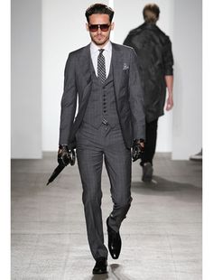 A really well fitting three piece suit. Especially in grey bleeds brit.