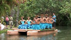 Polynesian Cultural Center in Laie Oahu Hawaii. Canoe show with dancers from Hawaii. Demonstration for tourists in the main lagoon. Blue skirts on beautiful dancers. Water, lagoon and palm trees. - HD stock footage clip