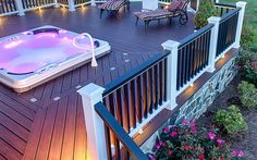 Cool nights and hot tubs enhanced by our splinter-free Trex Transcend decking in Lava Rock and Spiced Rum