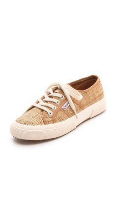 Classic Superga sneakers take on a rustic feel in rustic woven raffia with tonal canvas trim. Crepe sole.