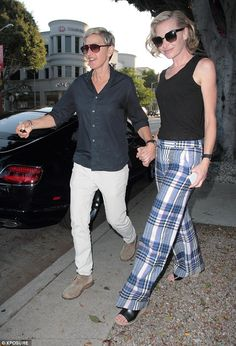 Holding hands: Ellen DeGeneres (left) and wife Portia De Rossi (right) pictured leaving Ma...